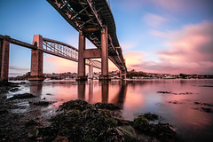 Brunel Sunrise (NikNak Allen) Tags: plymouth devon saltash cornwall tamar tamarriver tamarbridge brunel trainbridge roadbridge railwaybridge seaweed shoreline river water reflection reflections bridges light shadow sky cloud clouds sunrise early morning low below beneath longexposure crossing bridge architecture brick concrete