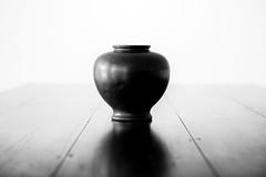 why an empty vase, she asked. (Tony Macrellis) Tags: urn vase japanese bw blackandwhite tabletop japaneseurn bronze loss death forgiveness love anticipation mystery