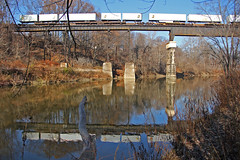 NS 206 in Conneaut (craigsanders429) Tags: reflectionphotographs reflectionphotography norfolksoutherntrains nslakeeriedistrict conneautohio conneautcreek nsinconneautohio rivers water waterways bridges railroadbridges railroadtrestles intermodaltrains nsintermodaltrains