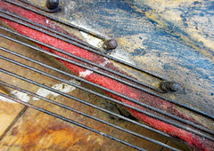 Strings inside an old piano (Monceau) Tags: piano old strings inside red blue dust macromondays memberschoicemusicalinstruments musicalinstrument macro wood lines wires interior texture