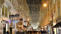 unterm Lichterhimmel  -  under the lights sky  -  sotto il cielo di luci (karinrogmann) Tags: kohlmarkt wien weihnachtsbeleuchtung einkaufsstrase