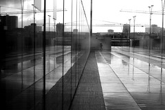 Between the waters (pascalcolin1) Tags: paris13 bnf femme woman reflets reflection vitres windows pluie rain photoderue streetview urbanarte noiretblanc blackandwhite photopascalcolin 50mm canon50mm canon