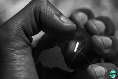 Global Domination (smzoha) Tags: macromonday macro finger fingertips globe world bw minimal hand 7dwf