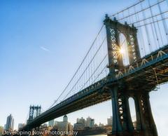 Dividing Light (nywheels) Tags: bridge manhattanbridge sky nyc newyorkcity thebigapple bigapple brooklyn manhattan water sun sunrays nikon creative