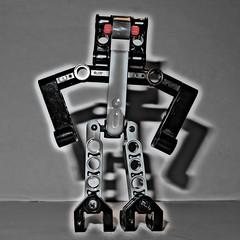 Mr. Red Eye (genelabo) Tags: genelabo mr red eye grey grau photoshop lego technic shadow canon g16