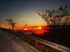 The way to sunset (panoskaralis) Tags: sunset sunlight sun sunrays road path sky bluesky clouds sea mountains mountainside evening nature greece greek hellas hellenic aegean aegeansea lesbian lesbos lesvosisland lesvos mytilene