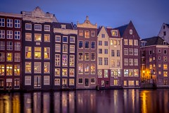 Night shot ofCanal houses on Damrak in Amsterdam (altextravel) Tags: netherlands amsterdam ancient architecture background beautiful blue building buildings canal canalhouse capital city cityscape dam damrak dusk dutch europe european exterior famous gracht grachtengordel grachtenpand historic historical holland house landmark light night north old outdoor panorama reflection river scene sky structure surreal tourism traditional travel twilight urban water waterfront