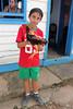 Young boy at tobacco farm (Allan Don Foley) Tags: youngboy cockerel rooster boy tobaccofarm cuba vinalescuba