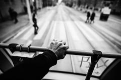 Hang On 71.365 (ewitsoe) Tags: tram rear train ride hangon 71 365 canon ewitsoe sigma street monochrome bnw blackandwhite city transit transportation cityscape urban polska pedestrian traffic move riding hand bodypart ring arm sleeve