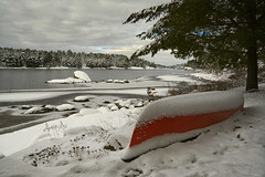 Time To Put The Canoe Away (Lindaw9) Tags: red canoe treeline lake trees snow november ice rock shoreline