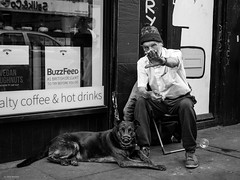 Muzzle Up (Silver Machine) Tags: london bricklane streetphotography street candid candideyecontact man sitting smoking grapes dog muzzle coffeeshop mono monochrome blackwhite bw fujifilm fujifilmxt10 fujinonxf35mmf2rwr
