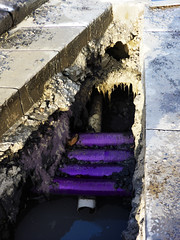 The Crossword Puzzle (Steve Taylor (Photography)) Tags: sewage broken architecture art digital pipe purple weird strange odd plastic block newzealand nz southisland canterbury christchurch ditch cbd city paving