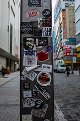 Tokyo Post (Blue Nozomi) Tags: sticker graffiti post akihabara street tokyo japan lamp