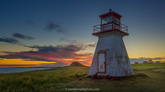 Phare du cap Alright au coucher du soleil (Yves Kéroack) Tags: grass septembre lowlight september phare summer colore magdalenislands stlawrencegulf coastal island horizontal seashore soir landscape havreauxmaisons capalright cloudy clouds sunset outdoor nuages evening sombre shore fleuvestlaurent lighthouse quebec colorful seascape nuageux rivage québec coucherdesoleil ilesdelamadeleine golfedustlaurent canada herbe coast îlesdelamadeleine seaside