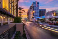 Rise and Shine Las Vegas! (tquist24) Tags: ballys flamingoroad lasvegas lasvegasstrip nevada nikon nikond5300 car city clouds fence geotagged lighttrails lights longexposure morning palmtree palmtrees sky street sunrise unitedstates