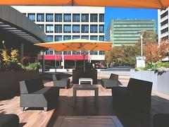 Seat Colors (jayplorin) Tags: seats buildings plaza san jose california windows blue sky outdoor lounge