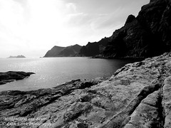 Moskenesøya and Beyond (liamearth) Tags: earth shore sky clouds mountain sceneic wind ripple wilderness beautiful sea view outdoor water western landscape wild snow lofoten norway arctic circle traveling fishing whiskey scapa moskenesøya å a camping rock cliffs bw contrast blackandwhite monochrome clear røst værøy