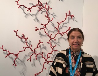 Gallerist Diane Lowenstein in her gallery's booth at Art Miami