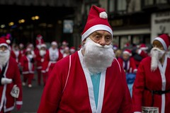 Christmas Is Coming (Leanne Boulton) Tags: urban street candid portrait portraiture streetphotography candidstreetphotography candidportrait streetportrait streetlife glasgowsantadash2017 fatherchristmas santaclaus man male face expression eyes tears crying mood emotion feeling sadness event christmas santa charity santadash tone texture detail depthoffield bokeh naturallight outdoor light shade bright red city scene human life living humanity society culture people canon canon5d 5dmkiii 70mm ef2470mmf28liiusm color colour glasgow scotland uk december