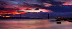 Showers at sunset (snowyturner) Tags: showers rain sunset portugal lisbon lisboa tagus bridge reflections longexposure clouds 25deabril panorama