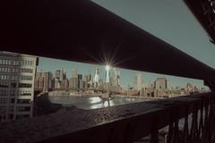 2417C (Panda1339) Tags: 28mm leicaq manhattanbridge sunrise worldtradecenter nyc architecture streetphotography usa summiluxq fence cforclassic