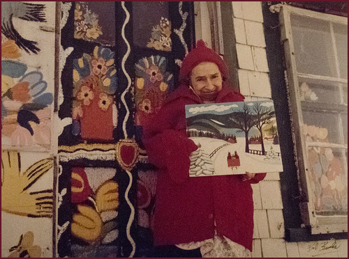 Photograph of Maud Lewis at the Front Door of Everett's and Her Home in Marshalltown (NS; c. 1960s) -- From the Art Gallery of Nova Scotia Halifax (NS) September 2017 DSC_2987