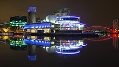 Calm at the Quays (G-WWBB) Tags: salfordquays salfordquaysliftbridge millenniumbridge millenniumfootbridge salfordquaysmillenniumfootbridge lowrysalfordquays lowry lowrybridge lowrytheatre theatre alchemist digitalworldcentre mediacityuk mediacity red blue green reflections reflect reflecting architecture cityscape night lights