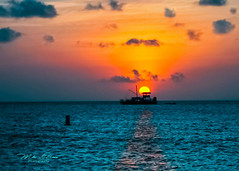 Fishing At Sunset (mikederrico69) Tags: dusk boat fishing sunset sun sky sea blue ocean peaceful aruba beach beaches boats carribean colorful clouds weather orange seaside summer seascape reflection reflections silouhette