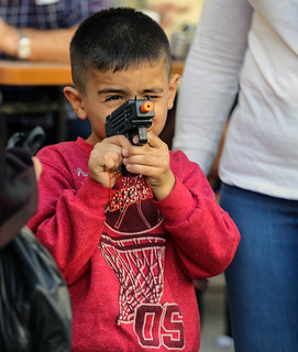 When a Palestinian boy is playing with (a model of) an Israeli submachine gun (Uzi), would you call it a coexistence?