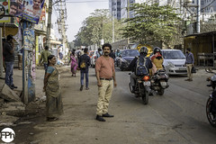 The man with striped shirt (Frankhuizen Photography) Tags: man with striped shirt woman bangalore bengaluru karnataka india street straat streetlife photography fotografie kleur color colour 2017 candid road people local sidewalk traffic standing looking rushhour car motor bike pavement motorcycle pedestrian alley city skidding ngr