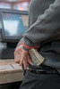 Employee stealing money (360iQ) Tags: stealing money pocket register employee working sneaky detail currency cash counter store crime criminal security surveillance fingers holding theft