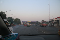 Views from the Road - Driving in Gujarat, India (November 23, 2017) (cseeman) Tags: india gujarat patan india17 india2017 indiatourism patantourism gujarattourism sightseeing indiasightseeing indiahistory gujarathistory cows cattle street streetscenes patanstreetscenes patolasari sari dogs indiandogs indianferaldogs freerangingdogs indianfreerangingdogs feraldogs cars trucks road indianroads hornplease scooters motorcycles indianhighway2017