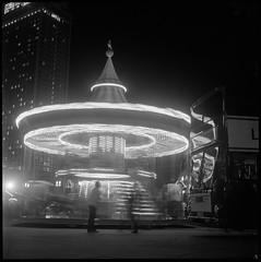 Oktober auf dem Platz (argentography) Tags: alexanderplatz berlin germany yashica 124 ilford hp5 merrygoround carousel blackandwhite neon monochrome