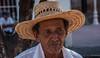 2017 - Mexico - Comala - Tuba Vendor (Ted's photos - For Me & You) Tags: 2017 comala cropped mexico nikon nikond750 nikonfx tedmcgrath tedsphotos tedsphotosmexico vignetting face portrait head hat strawhat beard moustache