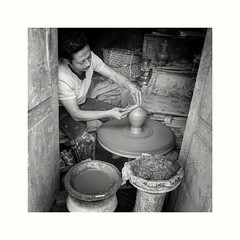 A potter and his wheel (posterboy2007) Tags: nepal potter wheel pottery street clay wheelthrownpottery pot pots sony bhaktapur
