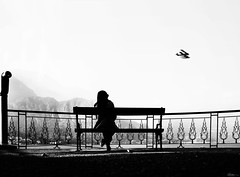 I wish I could fly! (René Mollet) Tags: fly woman lake lakefront lakeside lakecomo blackandwhite bw street streetphotography shadow silhouette streetart streetphotographiebw surprise airplain renémollet