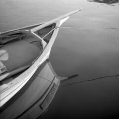 A boat - Stintino - Sardinia - August 2016 (cava961) Tags: boat reflection stintino sardinia monochrome monocromo analogue analogico bianconero bw 6x6