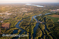 Bridge spans across wetlands to connect both sides of town, North Carolina (Remsberg Photos) Tags: aerial marshlands estuary waterway winding ecosystem water dusk coastal seaside passage highway across vegetation trees warmth windy transporation flow wetlands connect none northcarolina usa