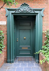 Green doorway, East 64th Street, Manhattan (Spencer Means) Tags: house doorway shell hood carving wood carved dark green street east 64th eastside manhattan newyork ny nyc city urban front molding moulding dwwg