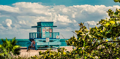 A kiss in Haulover. (Aglez the city guy ☺) Tags: hauloverbeach lifeguardhouse miamibeach miamifl beachscape beach colors clouds beautifulpeople seashore seascape green dunes waterways walking walkingaround outdoors people