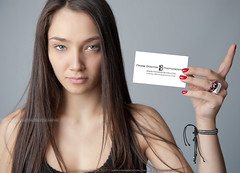Young woman holding card (Frank Boston Photographie) Tags: woman girl young hold blank card paper communication copyspace brunette pretty casual caucasian person sign reminder business note message empty longhair greeneyes 20 serious attractive concept idea information customizable sexy