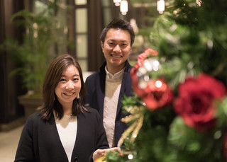 Young couple standing nearby Christmas tree