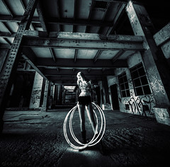 Hannah - LED hoops DSC4662-11 (cleansurf2) Tags: mood mirrorless monotone black background wallpaper tall square leadinglines lines hoops people portrait human element architecture abstract a7ii sony ilce7m2 14mm photography bw wideangle urban urbex underground scale woman beauty beautiful indoor industrial building