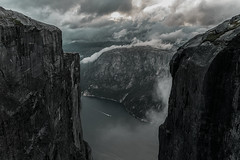 It's getting dark in the fjords. (Matthias Dengler || www.snapshopped.com) Tags: clouds dark mountain mountains scape landscape nature fog cloud mist haze misty fjord fjords sun contrast punchy darkness storm rain matthias dengler snapshopped boat ship water explore create travel hike cliff kjerag kjeragbolten norway lysefjord lysebotn norge norwegen norwegia dramatic scenery photography photographer photograph photo