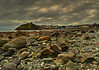 Back home. (alex.vangroningen) Tags: sky clouds castle village boulders sea colors houses light outdoors northwales uk peacefull