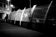 Against barriers (pascalcolin1) Tags: paris13 homme man nuit night lumières lights ombres shadows barriere barrier contre against photoderue streetview urbanarte noiretblanc blackandwhite photopascalcolin 50mm canon50mm canon