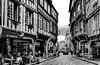 Street... (MickyFlick) Tags: dinan brittany france europe timberframedbuildings cafes restaurants bars peoplewatching mickyflick street streetscene blackandwhite bw cobbledstreets historical architectural touristattraction touristdestination