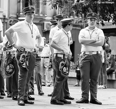 Drumband I (Bart van Hofwegen) Tags: bored boredom boring wait waiting band drumband uniform people boys street procession seville instrument music instruments blackandwhite monochrome
