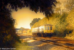 Going Home 2 (M C Smith) Tags: golden glow train track ballast bridge shade light shadow film slide blue white yellow