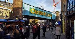 Back In The Town (standhisround) Tags: camdentown camden camdenmarket people scene london england uk northwestlondon buildings chairs seats tables bridge railway